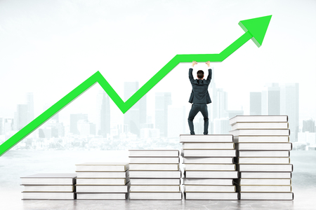 upholding: Education concept with businessman standing on book stairway and upholding green chart arrow on abstract city background. 3D Rendering