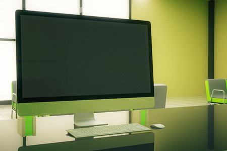 sideview: Sideview of blank computer screen in green office interior. Mock up, 3D Rendering