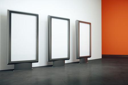 black floor: Three blank billboards in room with black floor, whte and orange walls. Mock up, 3D Rendering