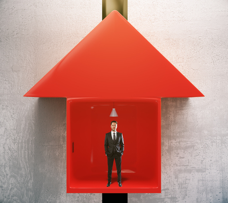 ascend: Success concept with businessman going up in red arrow elevator. 3D Rendering Stock Photo
