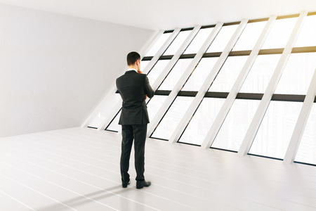 panoramic windows: Thinking businessman in white interior with panoramic windows. 3D Rendering Stock Photo