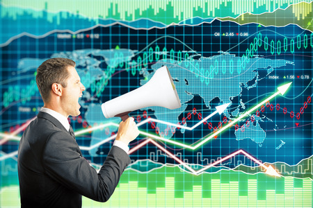 businessman using a megaphone: Businessman screaming into a megaphone on forex background with arrows going up and down