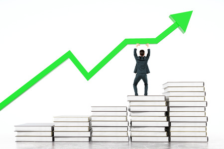 upholding: Education concept with businessman standing on book stairway and upholding green chart arrow on light background. 3D Rendering Stock Photo