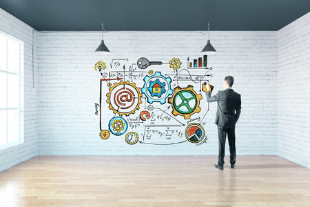 skecth: Businessman drawing business skecth on brick wall in room with wooden floor and window. 3D Rendering Stock Photo