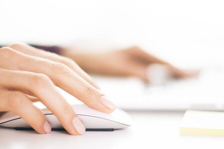 using: Closeup of businesswoman hands using computer mouse