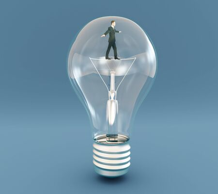 filament: Idea concept with businessman walking on filament inside lightbulb on blue background. 3D Rendering Stock Photo