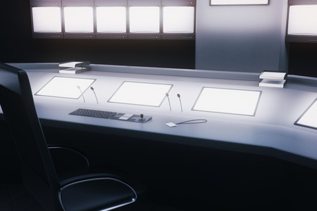 copy center: Side view of desk with blank screens in security room. Mock up, 3D Rendering Stock Photo