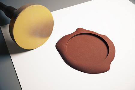 stamper: Paper sheet with blank golden stamper and brown seal on grey background. Mock up, 3D Rendering