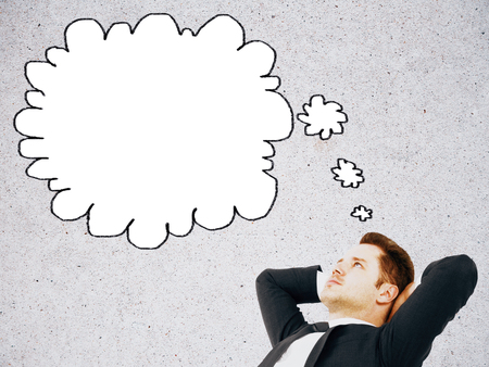 thought cloud: Relaxed businessman with thought cloud on concrete background. Mock up