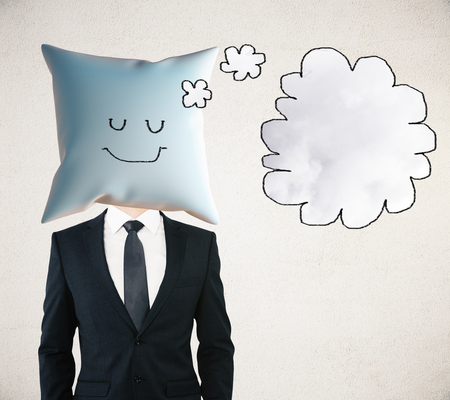 sleeping businessman: Sleeping businessman with smiley face on pillow instead of head dreaming about something with thought bubble. Mock up Stock Photo