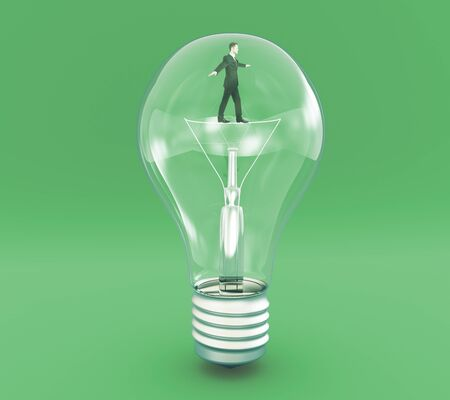 filament: Idea concept with businessman walking on filament inside lightbulb on green background. 3D Rendering Stock Photo