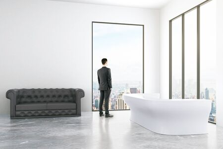 thoughtful: Thoughtful businessman in interior with reception, sofa, blank wall and windows with city view. Mock up, 3D Rendering