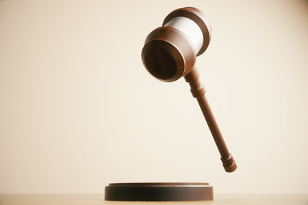 mid air: Wooden gavel in mid air on light background. 3D Rendering