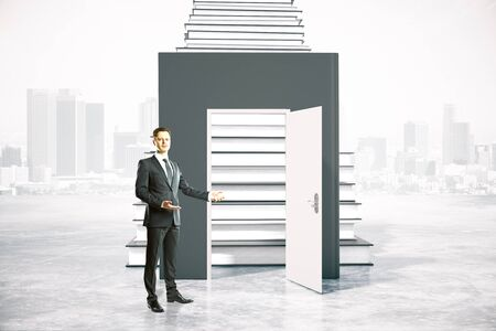 inviting: Education concept with businessman inviting to enter through an open door leading to book ladder. 3D Rendering Stock Photo