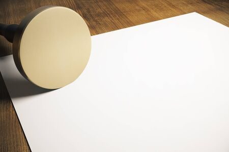validity: Golden round stamper and blank paper sheet on wooden background. Mock up, 3D Rendering