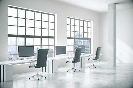 office computer: Coworking office interior with computers, concrete floor, walls, columns and windows with city view. 3D Rendering