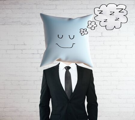 sleeping businessman: Sleeping businessman with smiley face on pillow instead of head