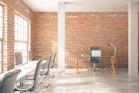 Coworking Office Interior With Computers, Concrete Floor, Red Brick Walls,  Columns And Windows