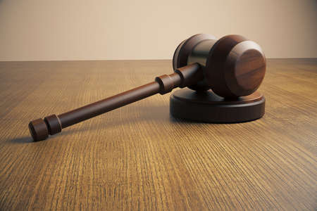 tabletop: Side view of judges gavel on wooden tabletop. Close up, 3D Rendering Stock Photo