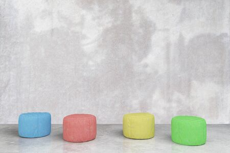 padded: Colorful padded stools in grey concrete room. 3D Rendering
