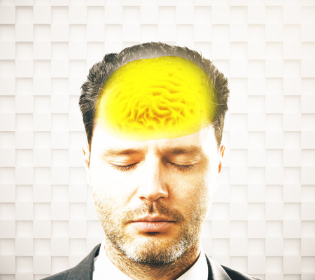 brainwaves: Brainstorming concept with businessman and abstract yellow brain on patterned background