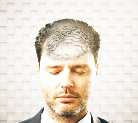 brainwaves: Brainstorming concept with businessman and abstract grey brain on patterned background Stock Photo