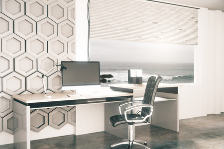 office window view: Side view of creative office desktop with honeycomb pattern on wall in the background and window with seaside view. 3D Rendering Stock Photo