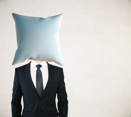 headed: Pillow headed businessman on concrete wall background. Mock up Stock Photo