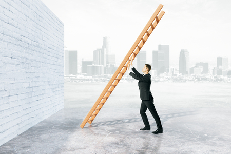 Obstacle overcoming concept with businessman pushing ladder to brick wall on foggy city background. 3D Rendering