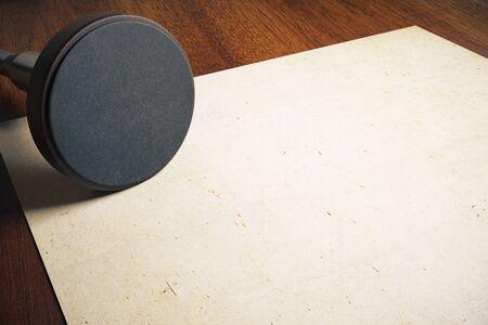 stamper: Round stamper and aged paper on wooden desktop. Mock up, 3D Rendering Stock Photo