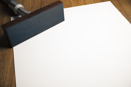 Rectangular stamper and blank paper sheet on wooden desktop. Mock up, 3D Rendering Stock Photo