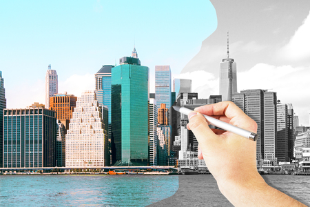 transforming: Males hand coloring black and white city with pen