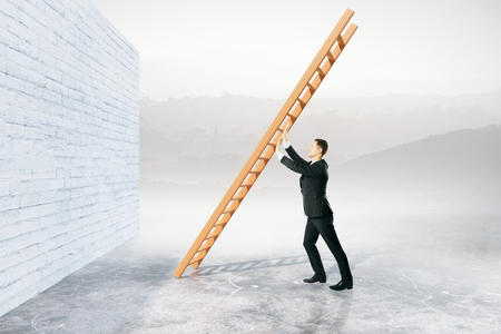 obstacle: Obstacle overcoming concept with businessman pushing ladder to brick wall on abstract background. 3D Rendering Stock Photo