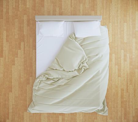 Bovenaanzicht van een onopgemaakt bed met beige deken en witte lakens op bruine houten vloer. 3D Rendering Stockfoto
