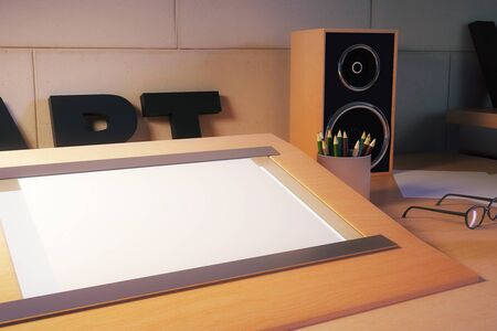 stationery items: Closeup of blank table easel on designers desktop with stationery items, glasses and loudspeakers. Mock up, 3D Rendering