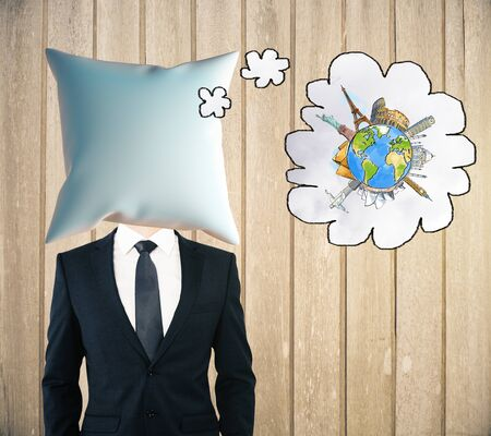 headed: Pillow headed man dreaming about traveling on wooden plank background. Mock up