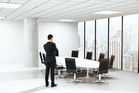 Brainstorming businessman in boardroom interior with round table, chairs, concrete column and panoramic window with city view. 3D Rendering