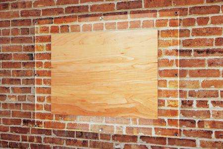 Blank wooden board under glass plate on red brick wall background. Mock up, 3D Rendering Reklamní fotografie