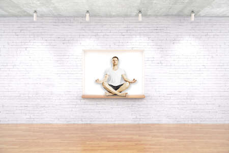 seating: Young man meditating on built-in-wall seating in white brick room with wooden floor. 3D Rendering Stock Photo