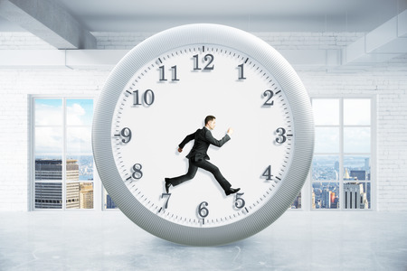 rushing hour: Time management concept with running businessman inside clock on empty interior background. 3D Rendering