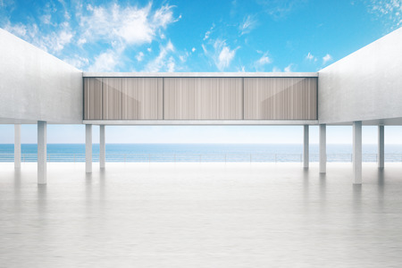 oceanside: Concrete exterior by the sea on bright blue sky background. 3D Rendering Stock Photo