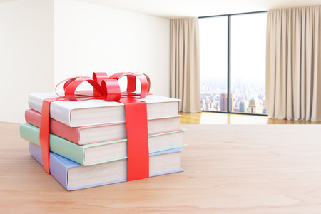 tied up: Wooden surface with stack of colorful books tied up with a ribbon as a present on interior background. 3D Rendering Stock Photo