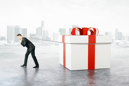 dragging: Businessman dragging huge present box on abstract city background. 3D Rendering