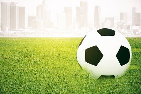 footie: Closeup of football on grass. Abstract city background. 3D Rendering