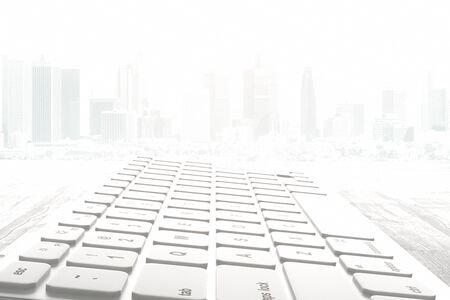 misty: Closeup and side view of white computer keyboard on abstract misty city background. 3D Rendering