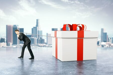 dragging: Businessman dragging huge present box on blurry city background. 3D Rendering