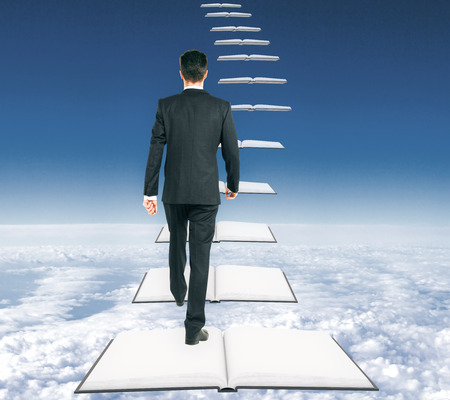 graduation suit: Businessman climbing abstract open book ladder on bright sky background. Success and education concept