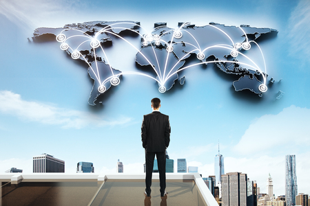 business globe: Global social networking concept with businessman looking at abstract map with network on city background