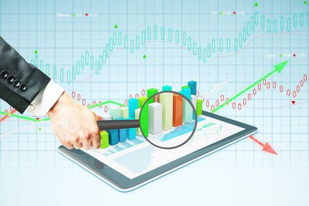 voluminous: Businessman hand holding magnifier over tablet with voluminous business chart bars. Market analysis concept. 3D Rendering