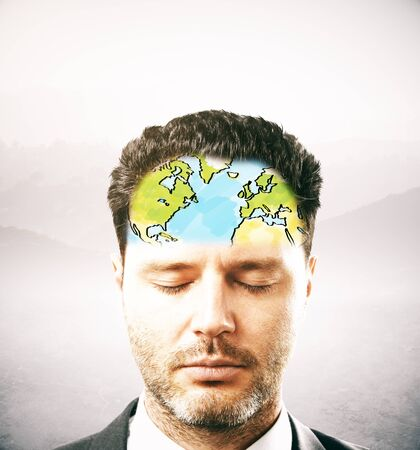 forehead: Portrait of thoughtful businessman with map on forehead. Light background
